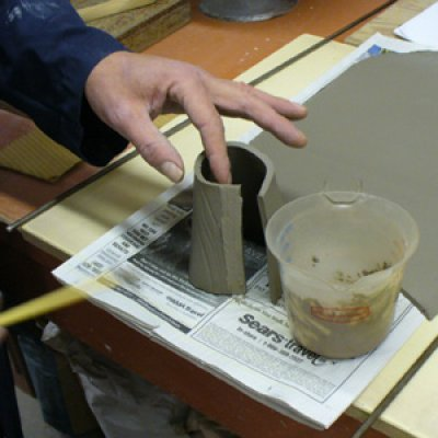Making a glaze testing cone: applying the slip for the join.