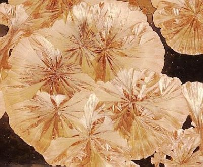 What could make glazes grow these incredible crystals?