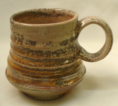A salt glazed mug fired at cone 10 in the kiln at the Medalta artist in residence program