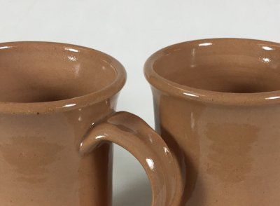 What is the secret of the higher gloss glaze on the right? Yikes, it is lead!