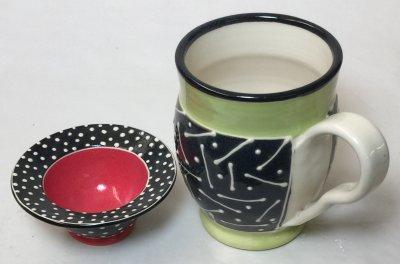 Cone 6 porcelain decorated via slip trailing