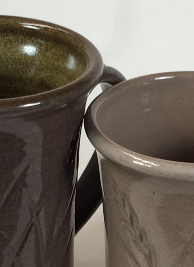 Two transparent glazes on the same dark burning clay. Why different?