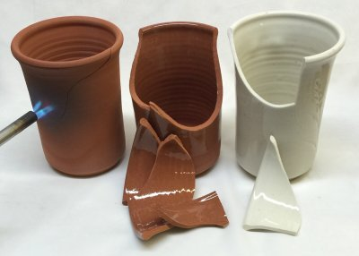 The porcelain is harder, but the terra cotta has it beat for thermal shock!